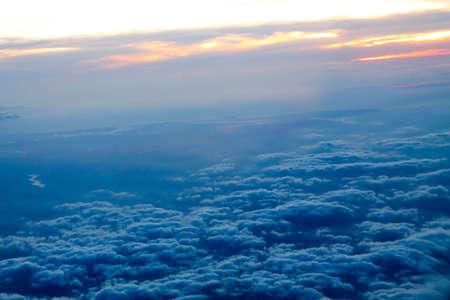 beneath: Gray sky beneath the flight. Stock Photo