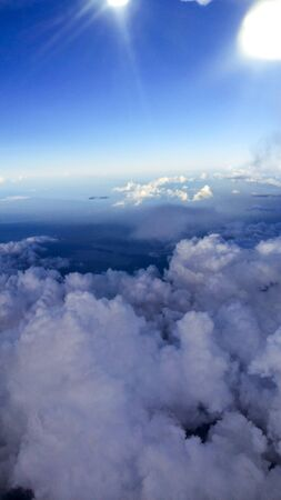 beneath: blue sky beneath the flight. Stock Photo