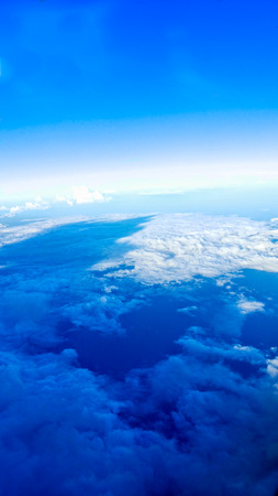 stratus: Blue sky beneath the flight.