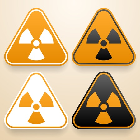 Set of triangular signs of danger of white, black and orange color  Radiation warning sign Stock Vector - 29231314