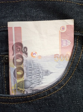 jeans that have Thai money in a bag