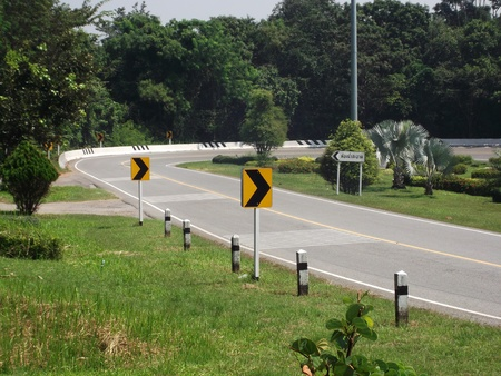 Traffic directional road signs pointing to right photo