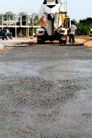 mounter: Pouring cement on newly paved road  Stock Photo