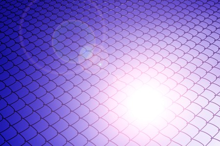 chainlink fence: The sun shines through chainlink fence Stock Photo