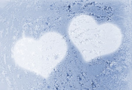 two hearts on the frozen glass photo