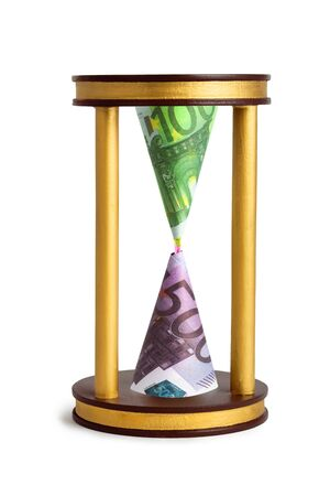 money and hourglass the concept of banking financial investment, color image isolated on a white background Stock Photo