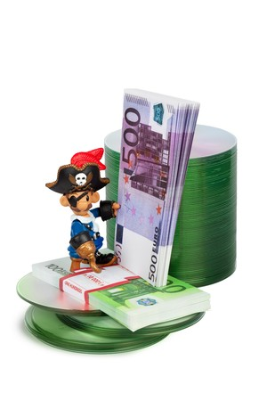 pirat toy with bundle of money and cd disks concept of software piracy Stock Photo - 7999766