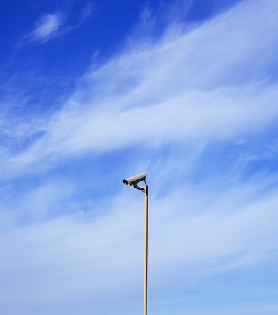 Singl video surveillance camera over the background of blue sky Stock Photo - 7999764