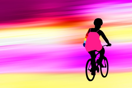 silhouette of african american woman on bike over the bright background Stock Photo