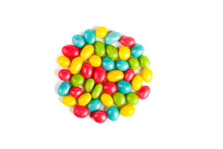 colored caramel sweets pebbles image isolated on a white background Stock Photo