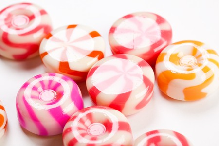 multi colored shiny caramel candies close-up Stock Photo