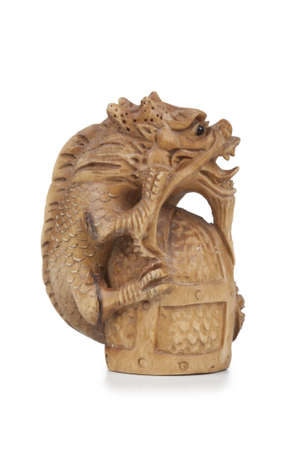 handicraft: wood or plaster figure of a dragon handicraft isolated on a white background