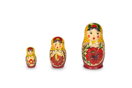 Three Russian dolls matreshka souvenir handicraft isolated on a white background