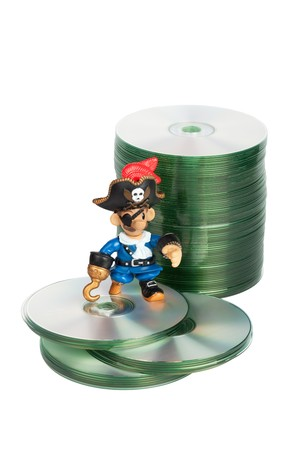 toy pirate and cd disks concept of software piracy color image isolated on a white background Stock Photo - 8156576