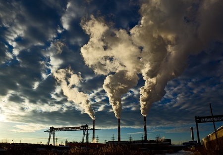 industrial  landscape, sky with clouds, the smoke from the chimneys of thermal power plants photo