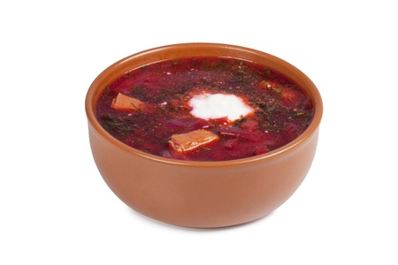 borscht: Russian soup borscht with sour cream in a brown ceramic high plate image isolated on a white background