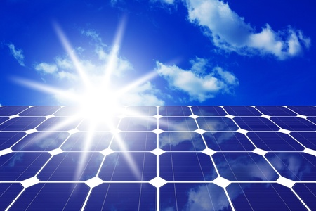 Image of solar panels - clean energy source on the background of sky and bright sun photo