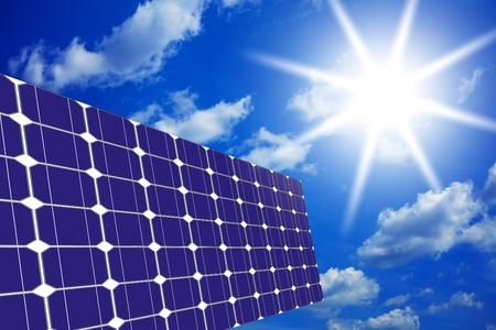 Image of solar panels - clean energy source on the background of sky and bright sun Stock Photo - 9393399