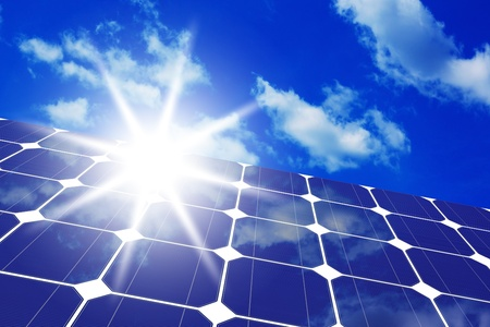 cloud industry: Image of solar panels - clean energy source on the background of sky and bright sun  Stock Photo