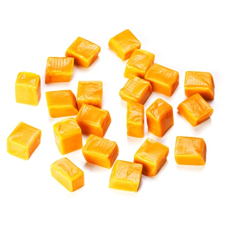 Caramel candy cube isolated on a white background Stock Photo