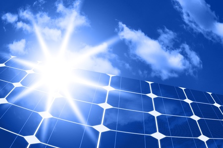 solar panels - clean energy source on the background of sky and bright sun  photo