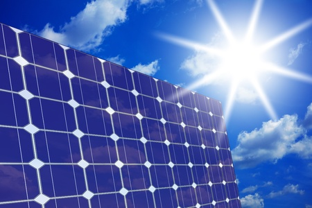 Image of solar panels - clean energy source on the background of sky and bright sun  Stock Photo