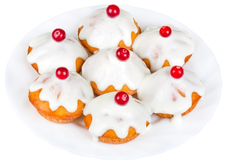 sour cream: delicious cakes with sour cream icing on plate, decorated with red berries, isolated on white background