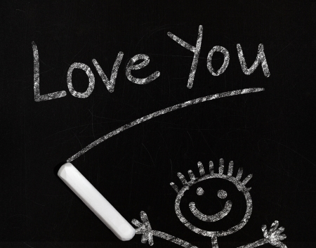 Love you phrase drawing with chalk on a blackboard photo