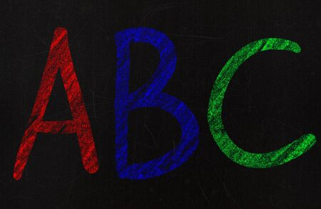 learning the alphabet in a primary school, drawing with chalk on a blackboard Stock Photo - 13663676