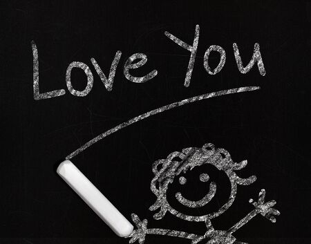 Love you phrase drawing with chalk on a blackboard