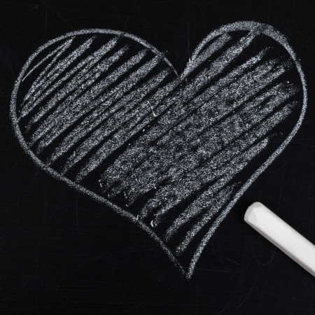 heart drawn in chalk on a blackboard