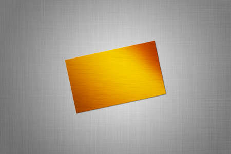 card with gold texture on the gray background Stock Photo