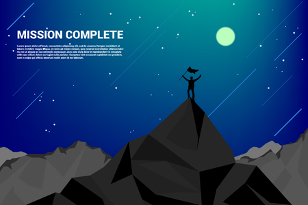 Silhouette of a business man on top of mountain: concept of success in career and mission