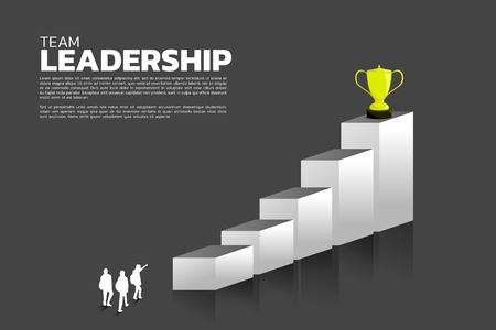 Silhouette group of businessman aim to champion trophy on top of graph. Business Concept of leadership goal and vision mission