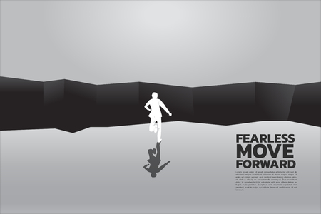 silhouette of businessman running to jumping over the gap. concept of business challenge and courage man