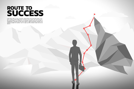 Route to the top of mountain: Silhouette of businessman with briefcase step forward to path to top of mountain.
