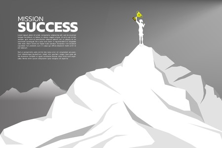 silhouette of businesswomen with the winner trophy standing on the top of mountain. Concept of Goal, Mission, Vision, Success in Career path.