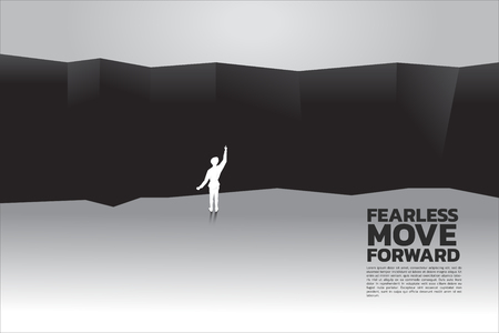 silhouette of businessman planning to cross abyss. concept of business challenge and courage man