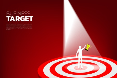 silhouette of businessman hold trophy on center of dartboard . Business Concept of marketing target and customer.Company vision mission and goal.