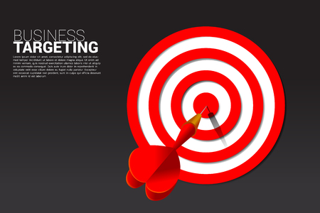 dart arrow hit the center of dartboard . Business Concept of marketing target and customer.Company vision mission and goal.