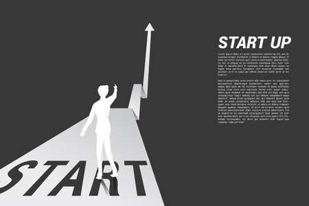 Silhouette of businessman point ahead from start line on growing graph. Concept of people ready to start career and business