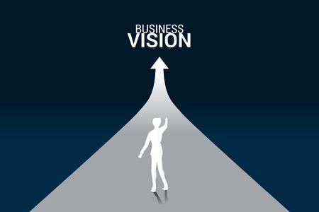 Silhouette of businessman point ahead on growing graph. Concept of people ready to start career and business
