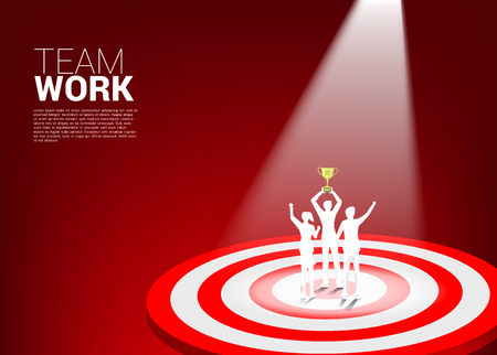 Silhouette of businessman and businesswoman with trophy on center of dartboard. business concept of teamwork and championship. win the market target