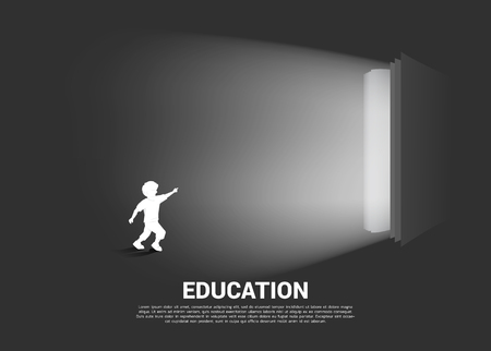 Silhouette of running boy point to light from open book. Concept of education solution. world of knowledge.