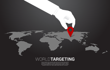 close up hand of businessman place location pin marker in front of world map. concept of a.i. learning machine and navigation system.