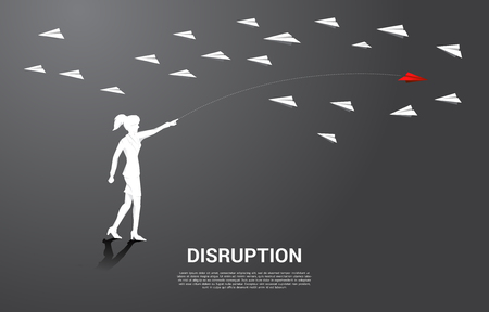 silhouette of businesswoman throw out red origami paper airplane opposite with others white. Business Concept of disruption and entrepreneur