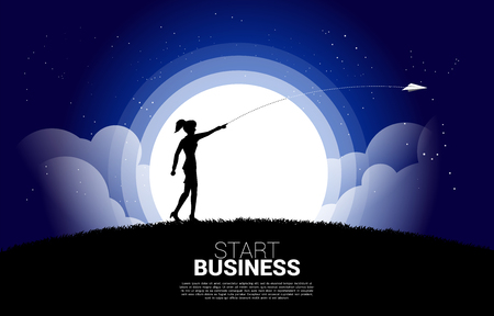 silhouette of businesswoman throw out origami paper airplane at night. Business Concept of start business and entrepreneur