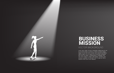 Silhouette of businesswoman point forward in spotlight. business concept of mission vision and leadership