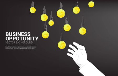 Business hand try to grabbing money falling from sky. Concept for business opportunity and economy