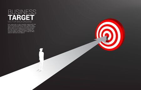 silhouette of businessman standing on route to center dartboard. Business Concept of route to goal and direct to target.